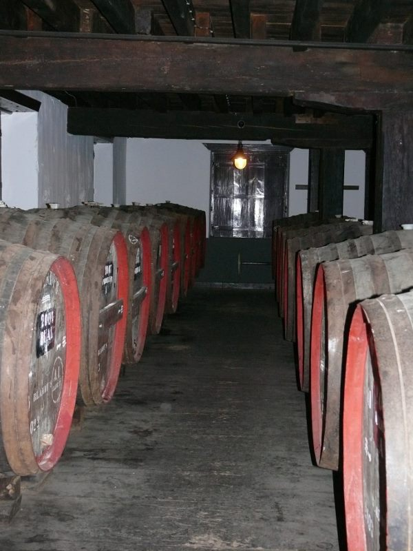 Barrels of Madeira maturing canteiro style at Blandy's wine lodge